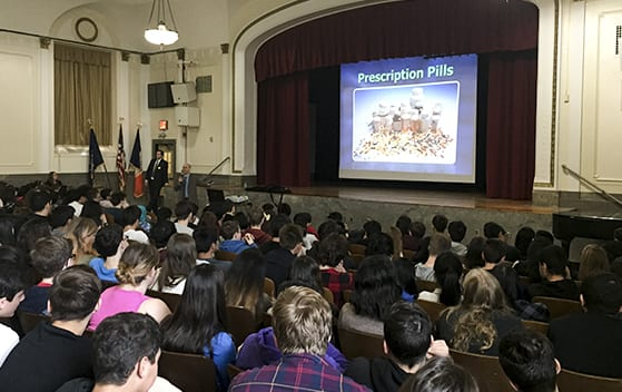 Inside a school auditorium presenting the NO-D program to students