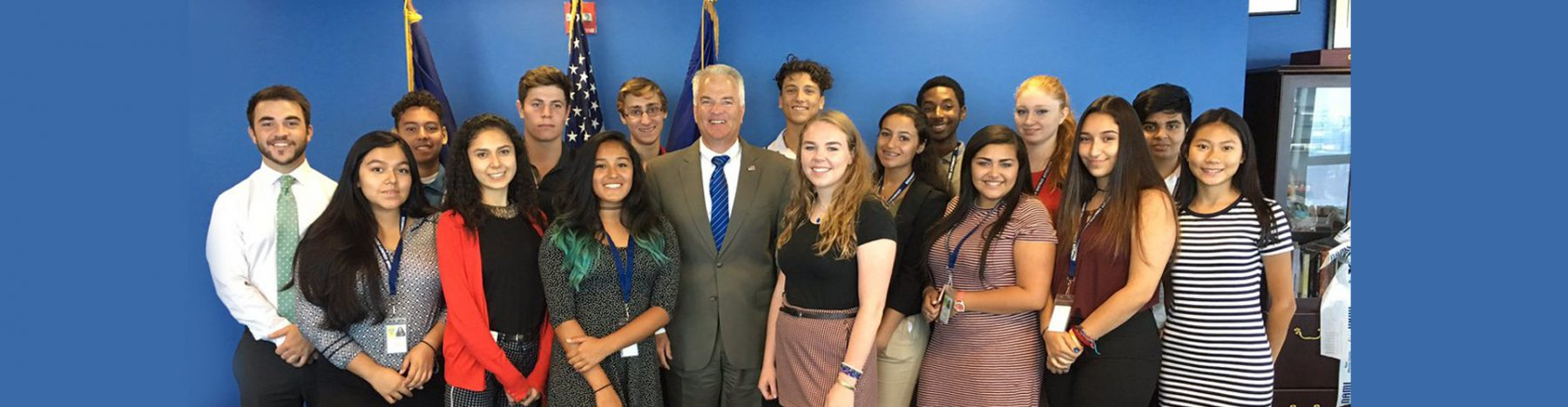 DA McMahon standing with Interns