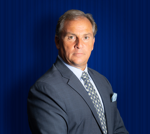 Mark Palladino profile picture man with grey hair and a grey suit