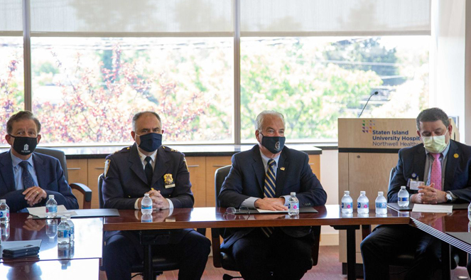 SIPPS Executive Director Joseph Conte, NYPD Assistant Chief Frank Vega, District Attorney Michael E. McMahon and SIUH Executive Director Brahim Ardolic sitting at a table